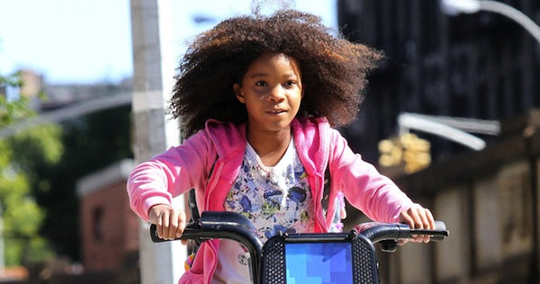 Quvenzhane Wallis rides a public bike while shooting the remake of 'Annie', on location in Harlem, NY