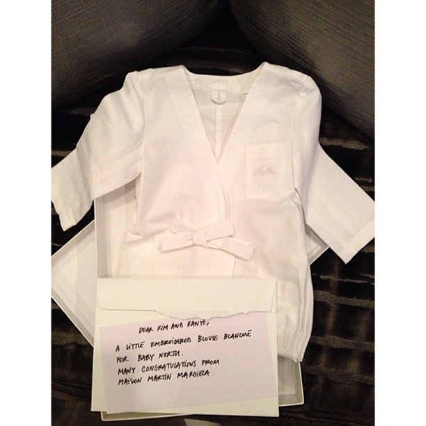 "Margiela offered a baby lab coat with a note that read: ""Dear Kim and Kanye, A little embroidered blouse blanche for baby North. Many congratulations from Maison Martin Margiela.""."